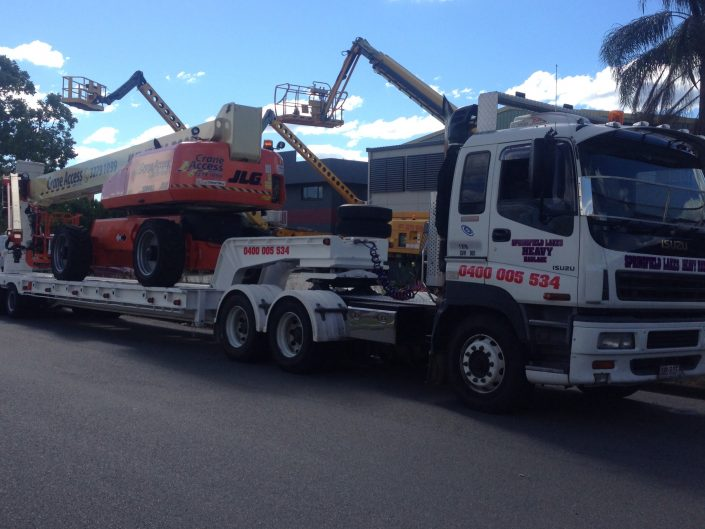 Towing Boom Lifts and Cranes