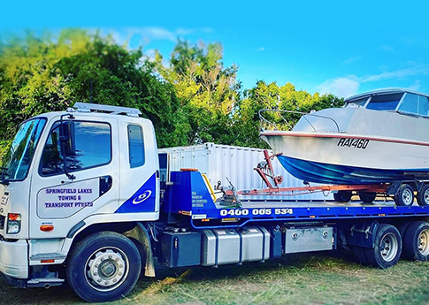 tow truck towing boat