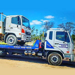 tow truck towing heavy vehicles