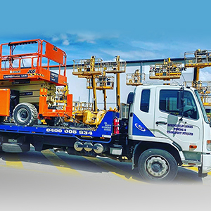 tow truck towing heavy equipment